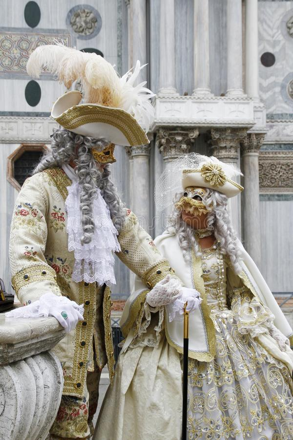Beautiful couple of masks at St. Mark square during the carnival of Venice. Italy royalty free stock image