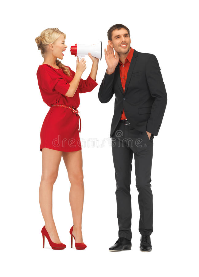 Beautiful couple with megaphone. Bright picture of beautiful couple with megaphone royalty free stock photo
