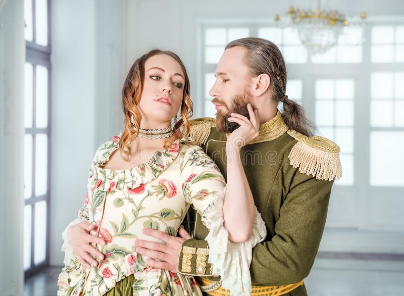 Beautiful couple man and woman in historical costumes stock photography