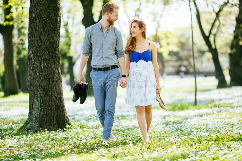 Beautiful couple in forest embracing love royalty free stock photos