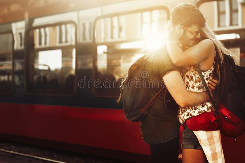 Beautiful couple parting at train station royalty free stock image