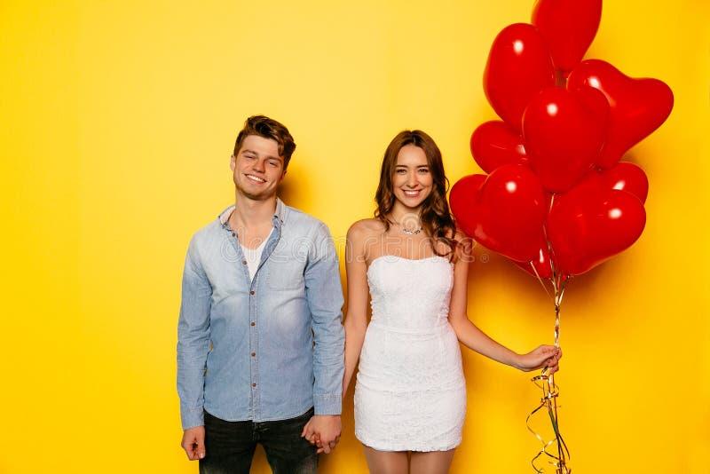 Beautiful couple posing at camera celebrating Valentine`s day royalty free stock photography