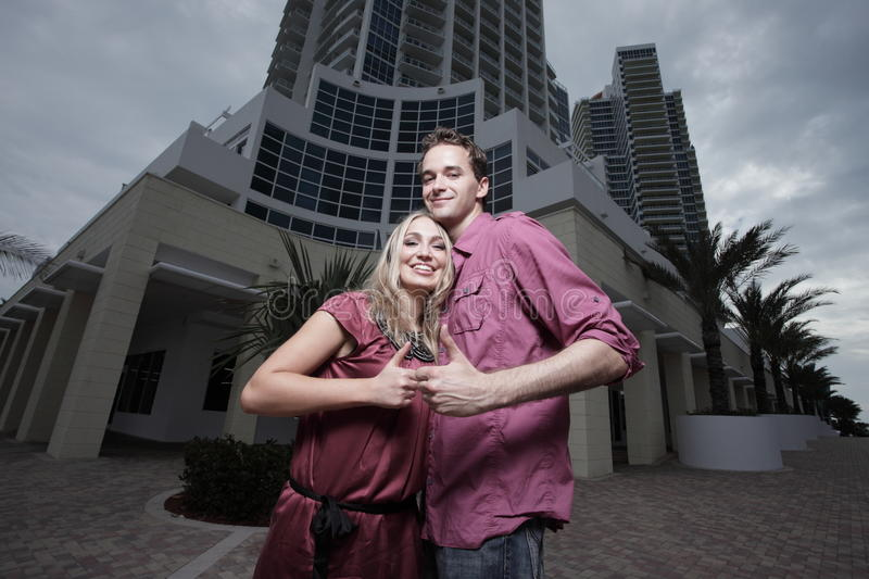 Download Beautiful Couple Showing Thumbs Up Stock Photo - Image: 13294340