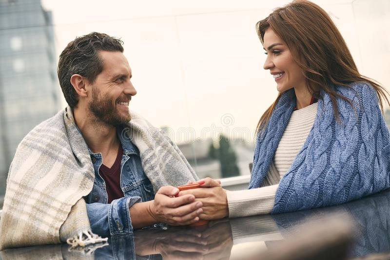 Beautiful couple is sitting in cozy cafe stock photos