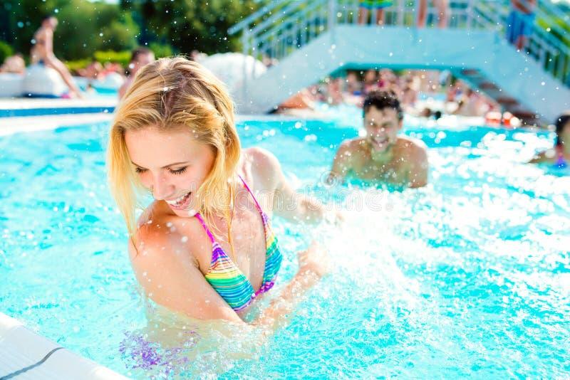 Beautiful couple in the swimming pool stock photo