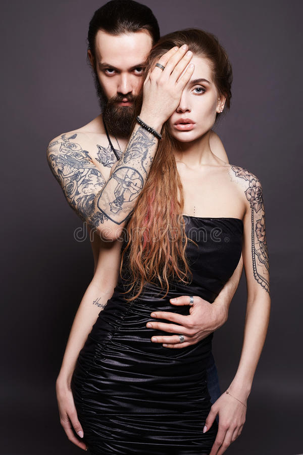 Beautiful couple together.Tattoo Hipster boy and girl. Fashion beautiful couple together.Tattoo Hipster boy and girl stock photography