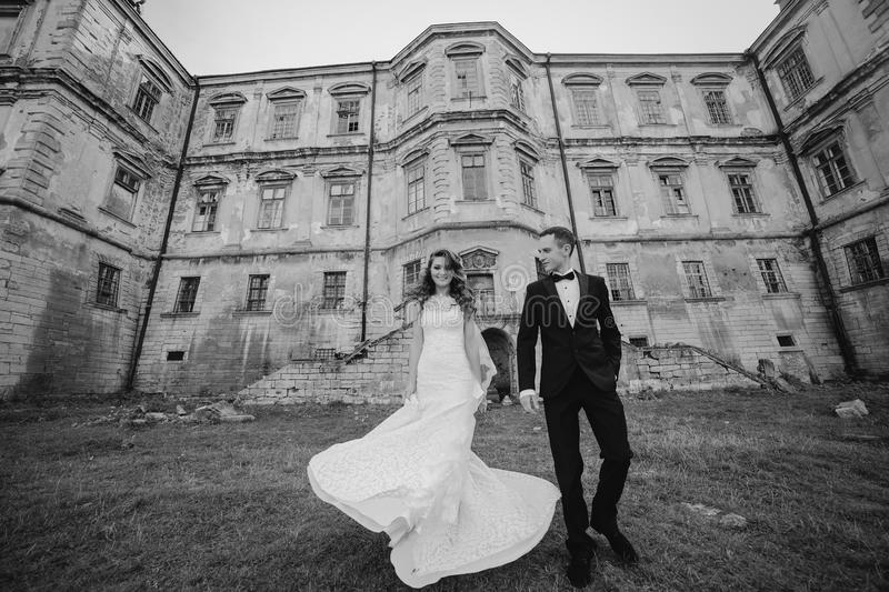 Beautiful couple wedding. Beautiful couple in wedding dress outdoors near the castle stock photo