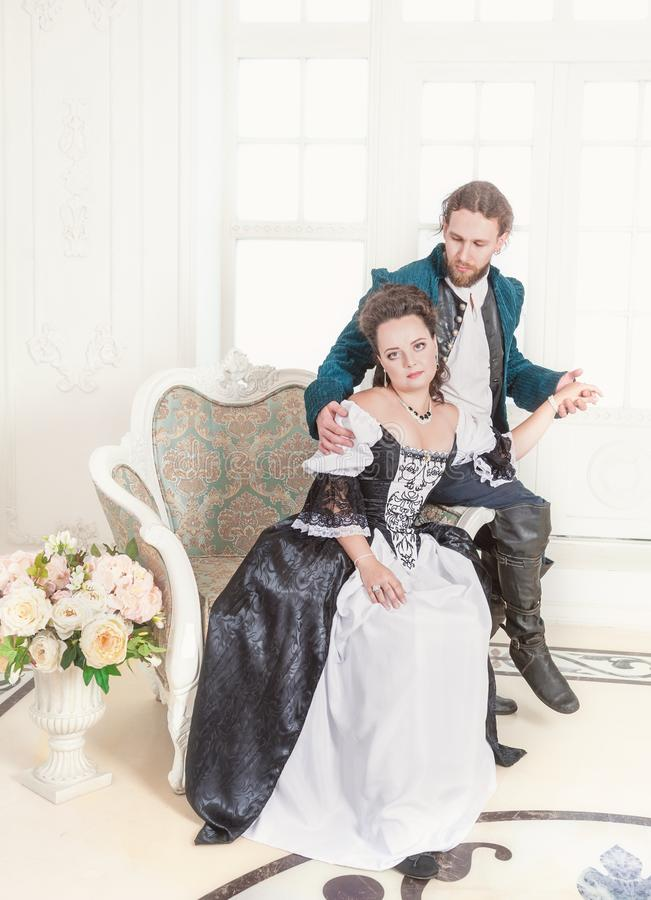 Beautiful couple woman and man in medieval clothes royalty free stock photos