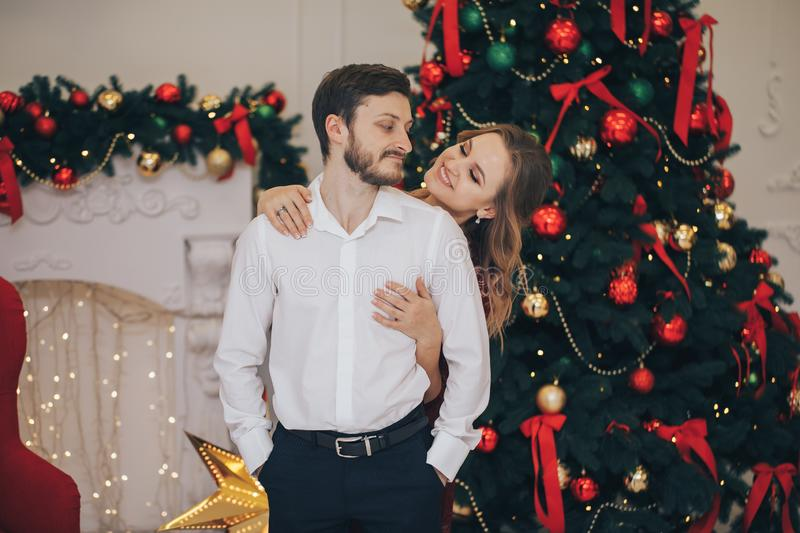Beautiful couple of young lovers are hugging indoors at home royalty free stock photography