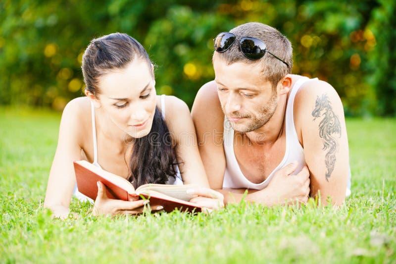 Beautiful couplereads book stock photography