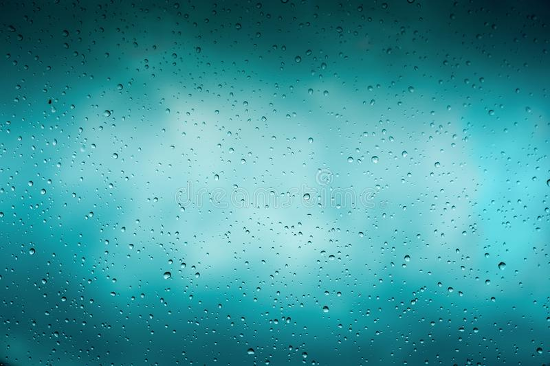 Beautiful cover of gradient background. Rain drops on glass with dark clouds. Greeting for design stock photo