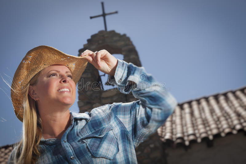 Beautiful Cowgirl Portrait With Old Church Behind Royalty Free Stock Photos