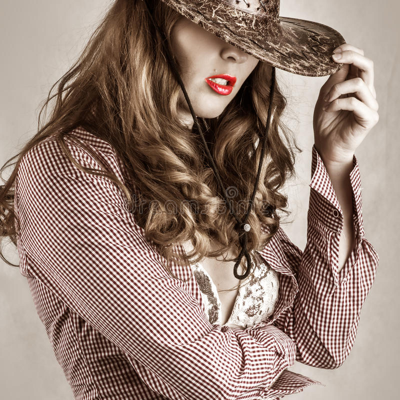 Beautiful cowgirl style woman wearing cowboy hat stock photography