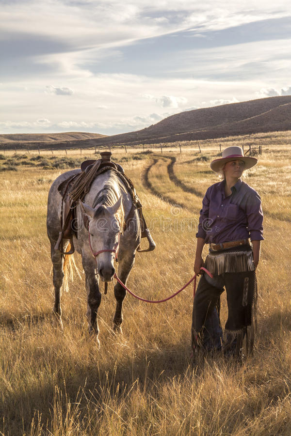 Free Beautiful Cowgirl With Horse Stock Image - 91288711