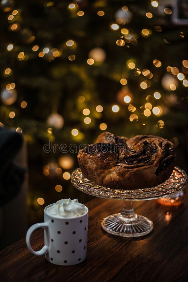 Beautiful and cozy Christmas breakfast consisting of home baked chocolate wreath with hot cocoa in a cute dotted cup. stock photos