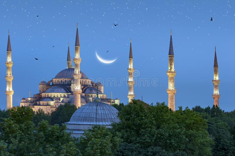 Beautiful crescent moon over Blue Mosque in Istanbul, Turkey royalty free stock image