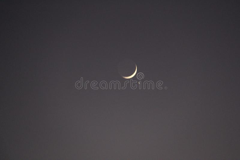 A beautiful crescent with star in sky royalty free stock image