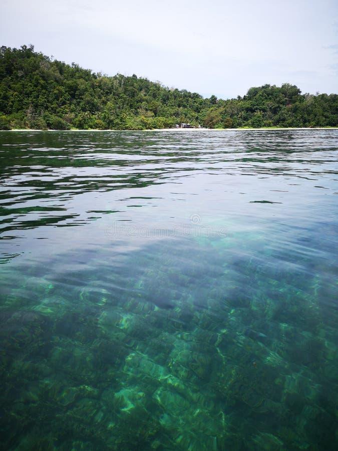 Crystal clear water with healthy coral reefs undersea from surface of Gaya Island, Tunku Abdul Rahman Park, Kota Kinabalu. Sabah,. Beautiful crystal clear water royalty free stock photography
