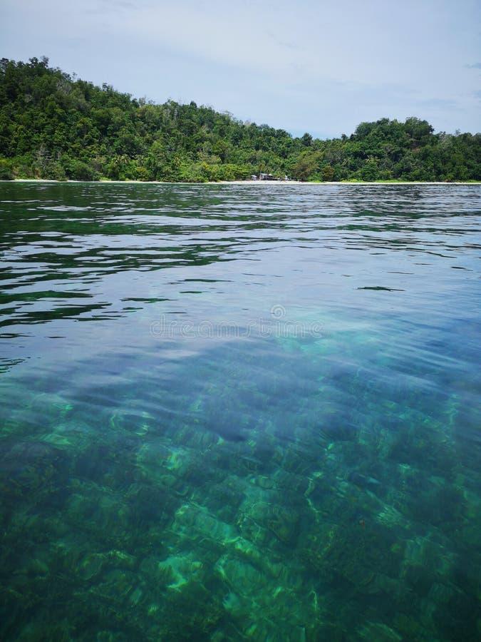 Crystal clear water with healthy coral reefs undersea from surface of Gaya Island, Tunku Abdul Rahman Park, Kota Kinabalu. Sabah,. Beautiful crystal clear water stock images