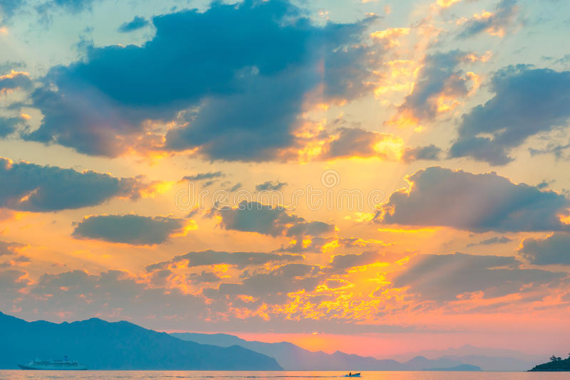 Beautiful cumulus clouds over the sea. At sunrise stock photo