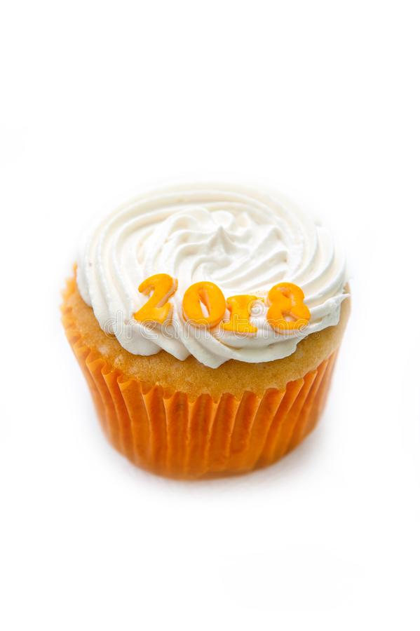 Beautiful cupcake with tender cream and figures 2018 on a white background stock photos