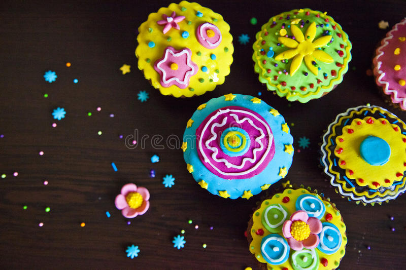 Beautiful cupcakes colorful decorations stock images