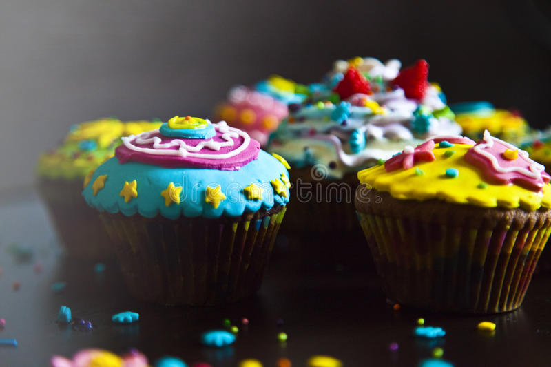 Beautiful cupcakes colorful decorations stock photography