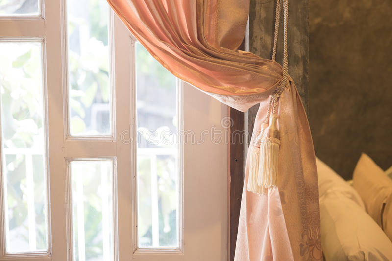 Beautiful curtain tie by curtain strap. With sunlight royalty free stock image