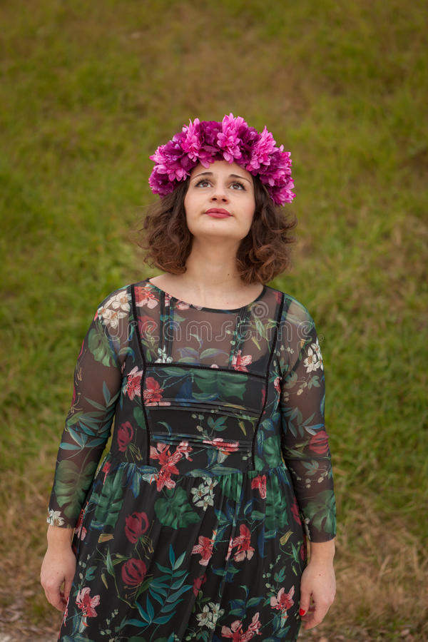 Beautiful curvy girl with a flower crown. In the landscape royalty free stock photos