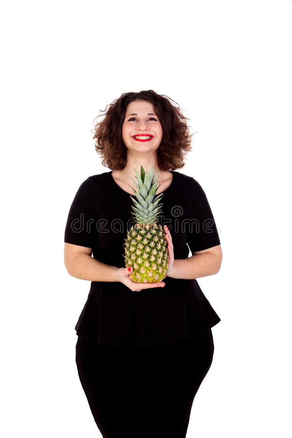 Beautiful curvy girl holding and pineapple. Isolated on a white background stock photo