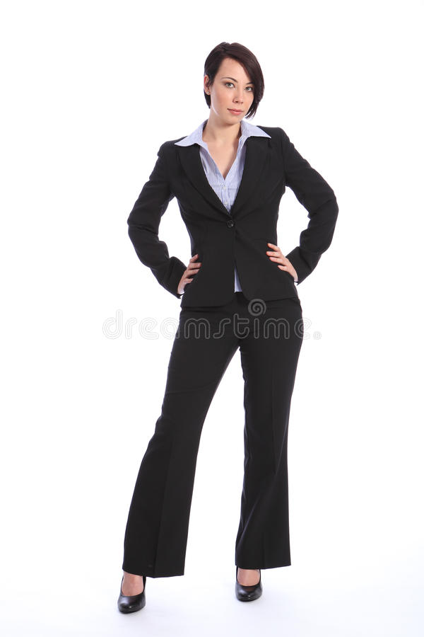Beautiful curvy young business woman in black suit royalty free stock photography