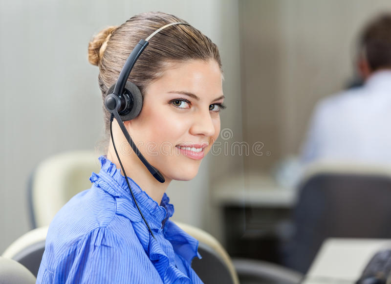 Beautiful Customer Service Executive Wearing royalty free stock photos