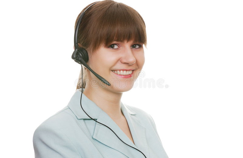 Beautiful customer support agent with headset. Smiling during a telephone conversation stock photo