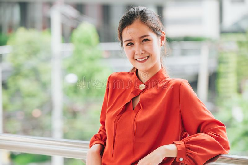 Beautiful cute Asian business young startup CEO working woman smiling confidence portrait stock image