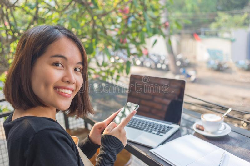 Beautiful cute asian young businesswoman using mobile phone stock image