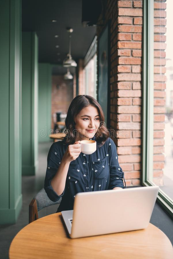 Beautiful cute asian young woman in the cafe, enjoy drinking coffee smiling royalty free stock photography