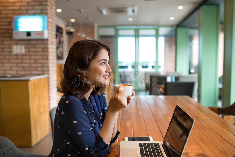 Beautiful cute asian young woman in the cafe, enjoy drinking cof. Fee smiling stock photo