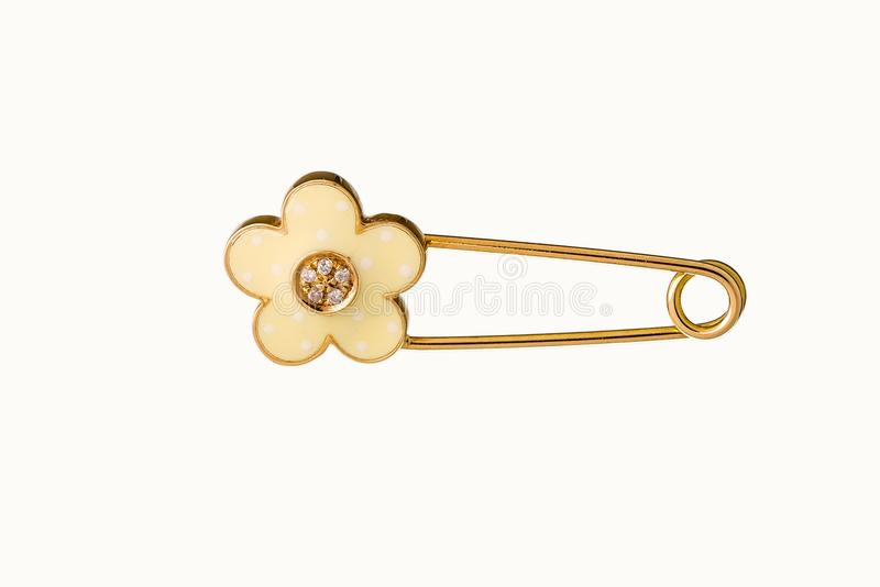 Beautiful Cute Baby & Kid safety Pin Brooch Jewelry with the safety pin design features a classic closure decorated throughout in. Yellow gold and diamond stock illustration
