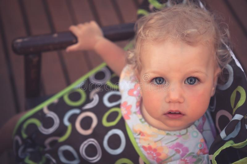 Beautiful cute child baby girl looking up at camera with view from above stock image