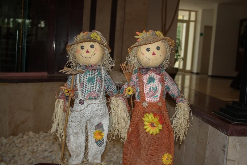 beautiful and cute couple of strawy dolls royalty free stock photos