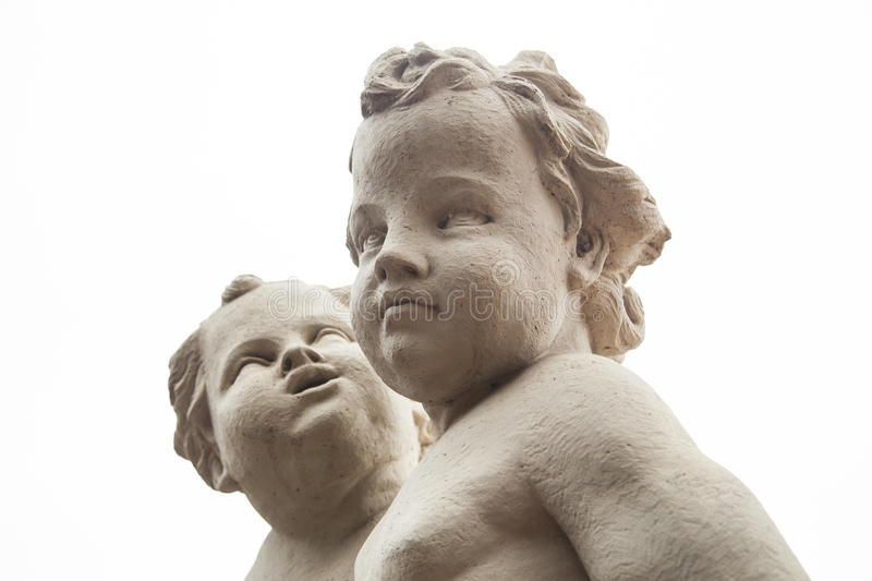 Beautiful cute faces of two angels child statue stock image