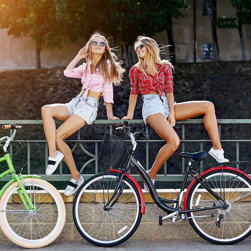 Beautiful cute girls with bicycles- outdoor summer portrait.