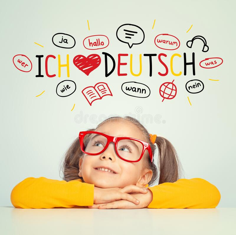 Free Beautiful Cute Little Girl  Looking At I Love German Text And Illustrations Stock Photography - 195892572