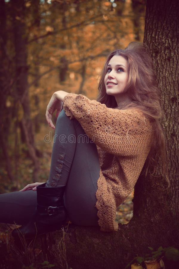 Beautiful cute woman resting in the forest. Beautiful cute young woman resting in the forest royalty free stock photo