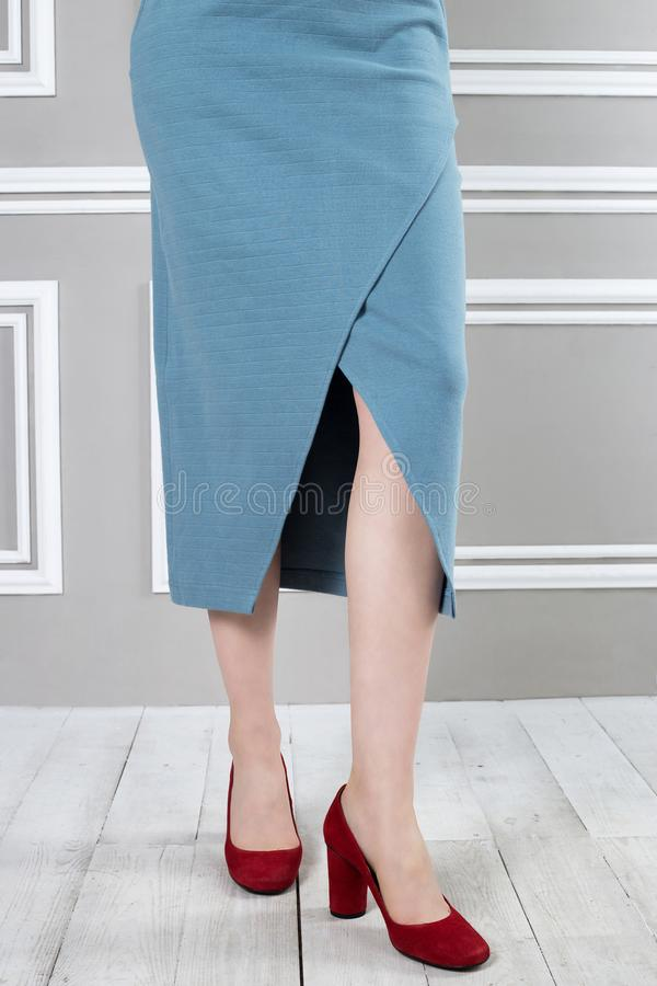 Beautiful cutout on skirt. Skirt with neckline, red shoes royalty free stock photos