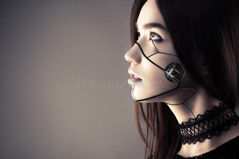 Beautiful cyberpunk girl with fashion makeup looking up royalty free stock photography