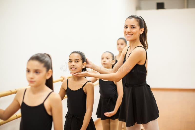 Beautiful dance teacher at work stock photos