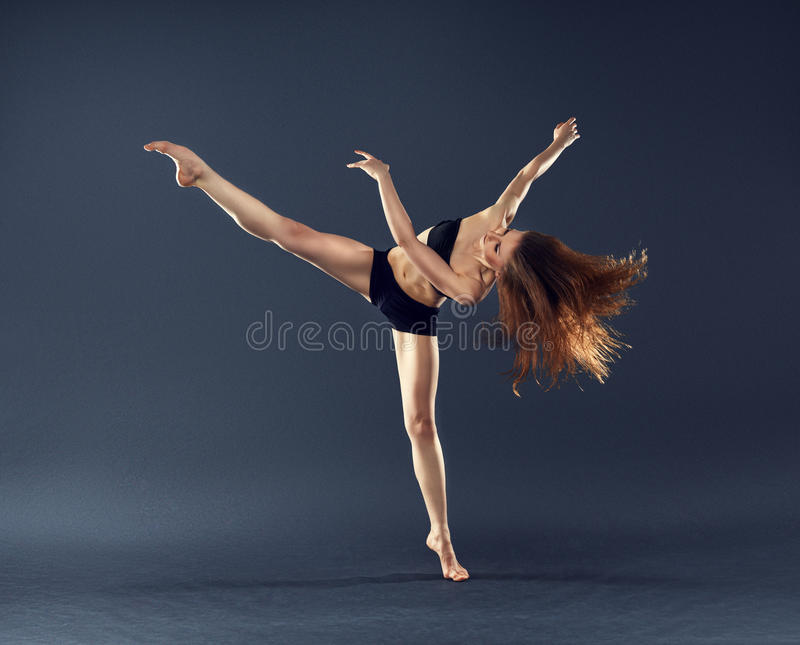 Beautiful dancer dancing dance ballet contemporary style. Beautiful dancer with flowing hair dancing dance ballet contemporary style stock images