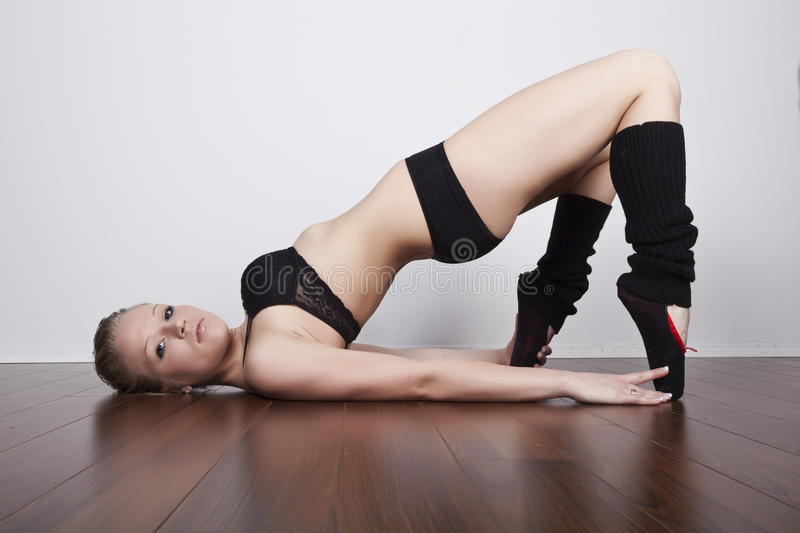 Beautiful dancer stretching stock image