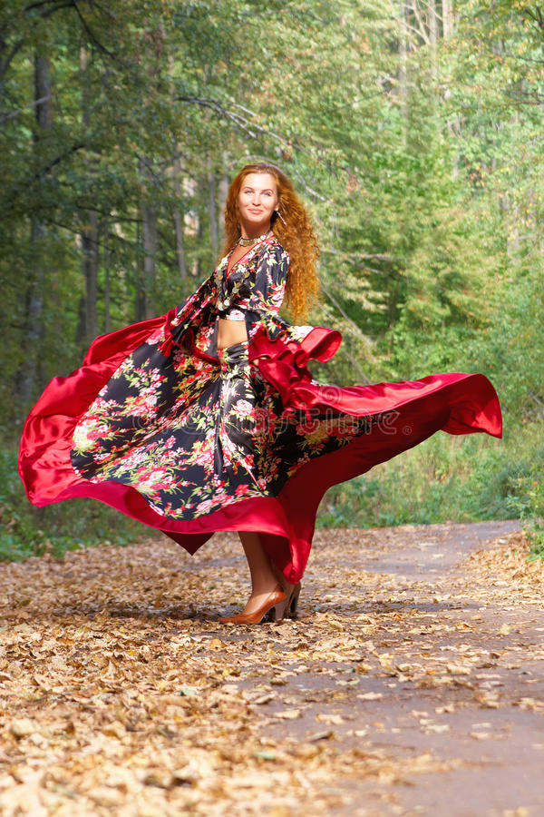 A beautiful dancing ginger-haired girl royalty free stock images